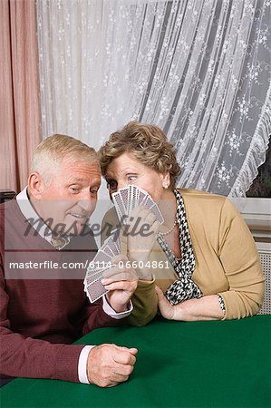 A senior couple gossiping Stock Photo - Premium Royalty-Free, Image code: 6114-06604861