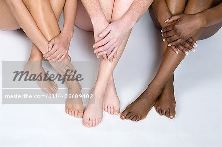 Legs of young women Stock Photo - Premium Royalty-Free, Image code: 6114-06609402