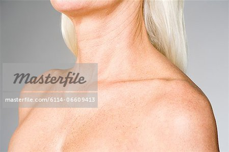 Female chest and shoulders Stock Photo - Premium Royalty-Free, Image code: 6114-06609413