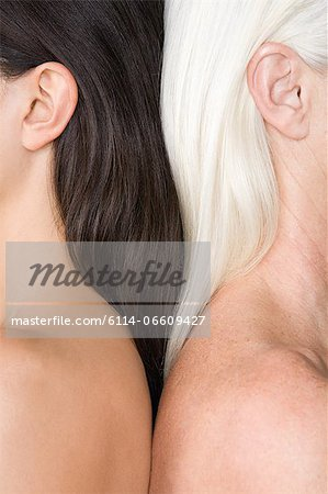 Women with dark and light hair Stock Photo - Premium Royalty-Free, Image code: 6114-06609427