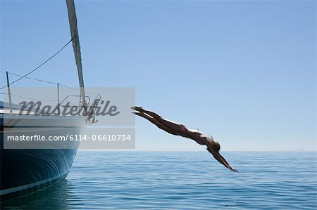 Woman diving into ocean Stock Photo - Premium Royalty-Free, Image code: 6114-06610734