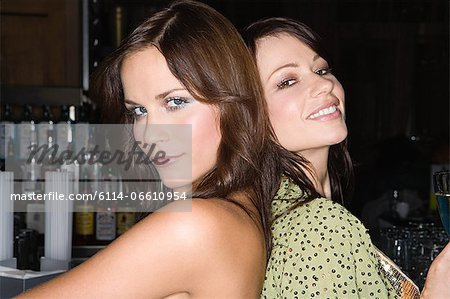 Two attractive women at a bar Stock Photo - Premium Royalty-Free, Image code: 6114-06610954