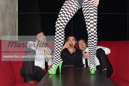 Men and legs of table dancer Stock Photo - Premium Royalty-Free, Image code: 6114-06610980