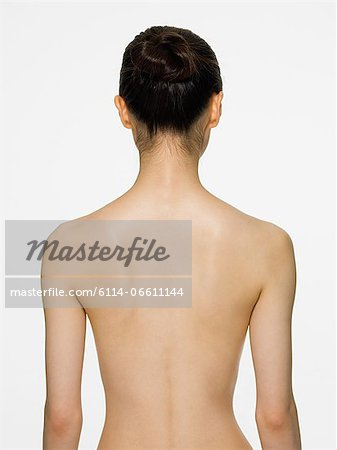 Rear view of a young woman Stock Photo - Premium Royalty-Free, Image code: 6114-06611144