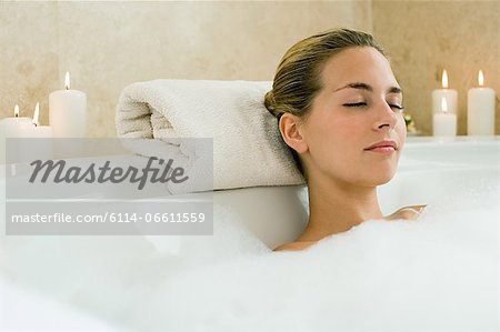 Woman bathing Stock Photo - Premium Royalty-Free, Image code: 6114-06611559
