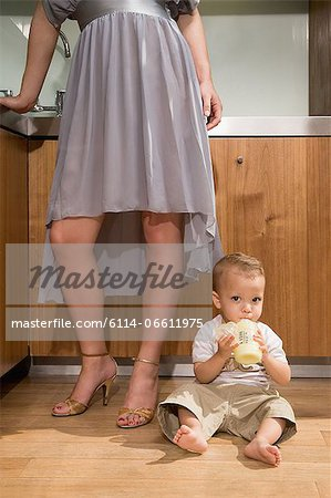 Woman in kitchen with baby Stock Photo - Premium Royalty-Free, Image code: 6114-06611975