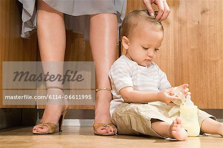 Baby at mother's feet Stock Photo - Premium Royalty-Free, Image code: 6114-06611995