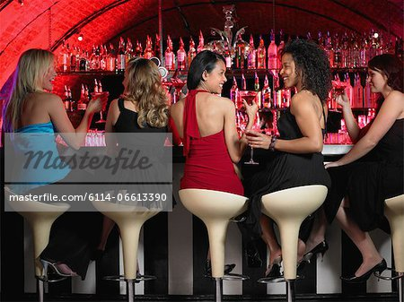 Five women sitting at bar Stock Photo - Premium Royalty-Free, Image code: 6114-06613390