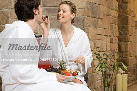 Couple eating fruit Stock Photo - Premium Royalty-Free, Image code: 6114-06646252