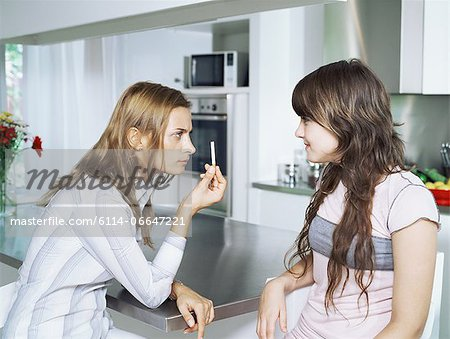Girl and mother with cigarette Stock Photo - Premium Royalty-Free, Image code: 6114-06647221