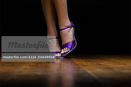 Woman wearing purple high heeled shoes Stock Photo - Premium Royalty-Free, Image code: 6114-06648838