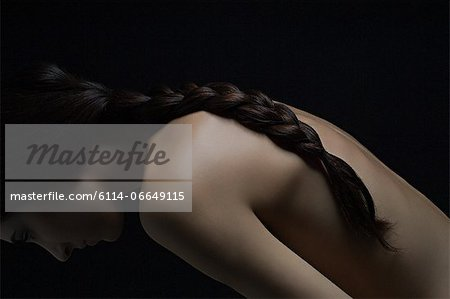 Nude woman with plaited hair Stock Photo - Premium Royalty-Free, Image code: 6114-06649115