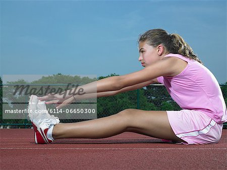 A girl stretching Stock Photo - Premium Royalty-Free, Image code: 6114-06650300