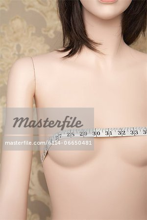Tape measure on a mannequins breasts Stock Photo - Premium Royalty-Free, Image code: 6114-06650481