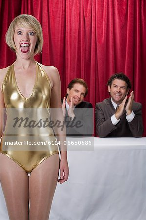 Surprised woman at a competition Stock Photo - Premium Royalty-Free, Image code: 6114-06650586