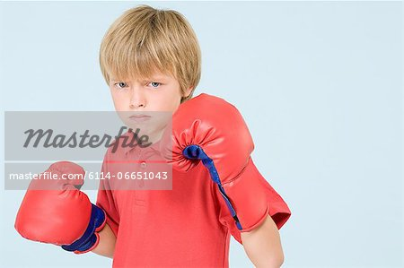 Boy boxing Stock Photo - Premium Royalty-Free, Image code: 6114-06651043