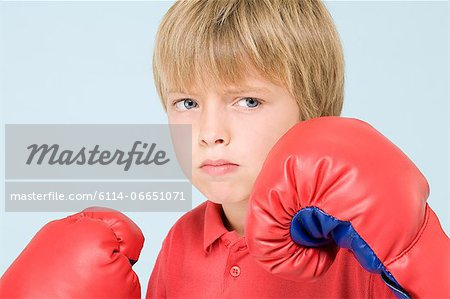 Boy boxing Stock Photo - Premium Royalty-Free, Image code: 6114-06651071
