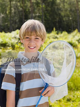 Boy with butterfly net Stock Photo - Premium Royalty-Free, Image code: 6114-06651758