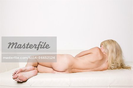 Rear view of a naked woman Stock Photo - Premium Royalty-Free, Image code: 6114-06652124