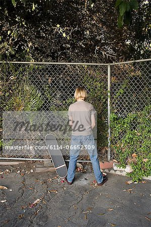 A boy urinating Stock Photo - Premium Royalty-Free, Image code: 6114-06652309