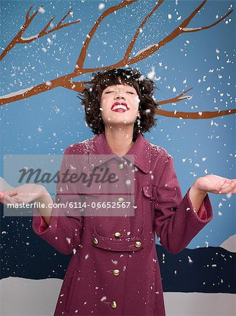 Woman in the snow Stock Photo - Premium Royalty-Free, Image code: 6114-06652567