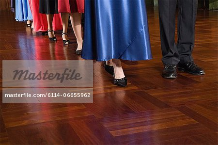 People in a row Stock Photo - Premium Royalty-Free, Image code: 6114-06655962