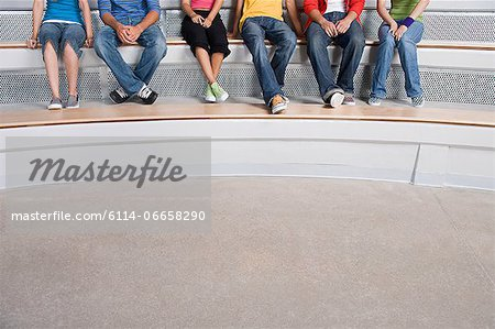 Young people sitting on a step Stock Photo - Premium Royalty-Free, Image code: 6114-06658290