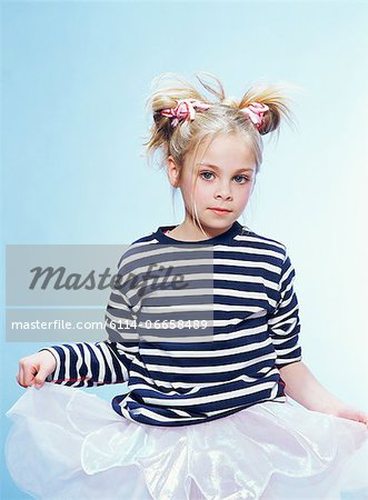Girl wearing a striped sweater and a tutu Stock Photo - Premium Royalty-Free, Image code: 6114-06658489