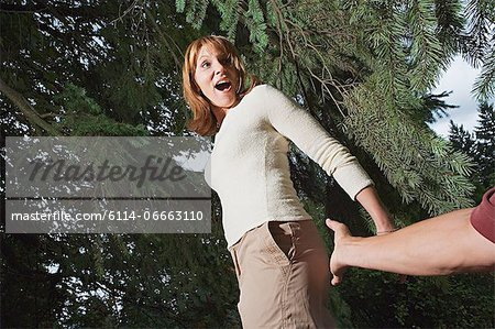 Man reaching to touch woman's bottom Stock Photo - Premium Royalty-Free, Image code: 6114-06663110