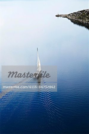 Croatia, Sailboat on the move, aerial view Stock Photo - Premium Royalty-Free, Image code: 6115-06732862