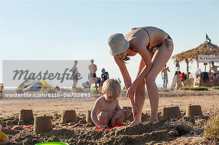 Croatia, Dalmatia, Mother And Son Playing On Beach Stock Photo - Premium Royalty-Free, Image code: 6115-06732893