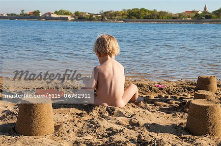 Croatia, Dalmatia, Baby Boy Playing on Beach Stock Photo - Premium Royalty-Free, Image code: 6115-06732911