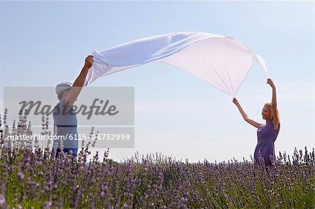 Young Couple Spreading Blanket In Lavender Field, Croatia, Dalmatia, Europe Stock Photo - Premium Royalty-Free, Image code: 6115-06732999