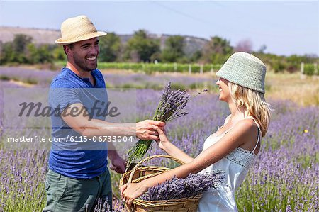 Young Couple in Lavender Field, Croatia, Dalmatia, Europe Stock Photo - Premium Royalty-Free, Image code: 6115-06733004