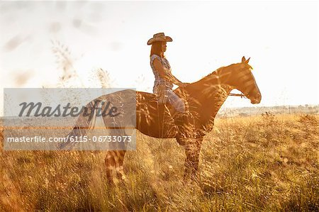 Croatia, Dalmatia, Young woman horseback riding Stock Photo - Premium Royalty-Free, Image code: 6115-06733073