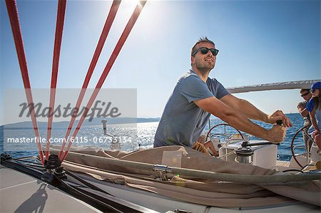 Croatia, Adriatic Sea, Young man on sailboat Stock Photo - Premium Royalty-Free, Image code: 6115-06733134