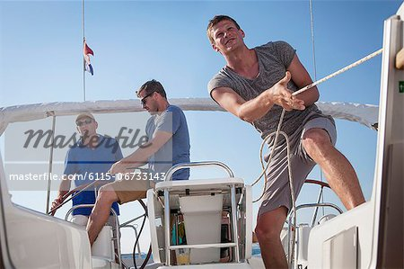 Croatia, Adriatic Sea, Young men on sailboat Stock Photo - Premium Royalty-Free, Image code: 6115-06733143