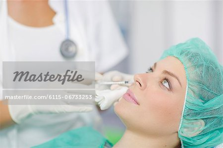 Patient Getting A Cosmetic Surgery Treatment Stock Photo - Premium Royalty-Free, Image code: 6115-06733253