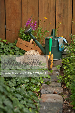 Garden equipment, flowers and straw hat in the garden, Munich, Bavaria, Germany Stock Photo - Premium Royalty-Free, Image code: 6115-06778642