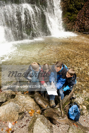 Family Looking At Map, Bavaria, Germany, Europe Stock Photo - Premium Royalty-Free, Image code: 6115-06778788