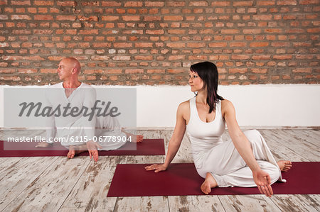 Couple Practising Yoga Stock Photo - Premium Royalty-Free, Image code: 6115-06778904