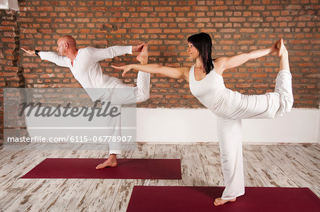 Couple In Yoga Pose Stock Photo - Premium Royalty-Free, Image code: 6115-06778907