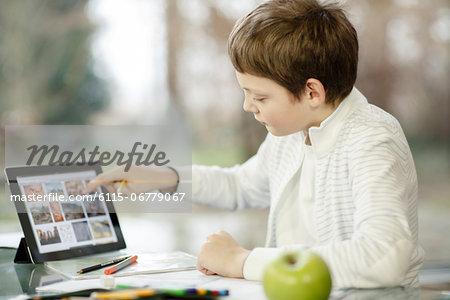 Boy using digital tablet, Osijek, Croatia, Europe Stock Photo - Premium Royalty-Free, Image code: 6115-06779067