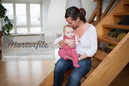 Young mother with baby girl at home, Munich, Bavaria, Germany Stock Photo - Premium Royalty-Free, Image code: 6115-06779105