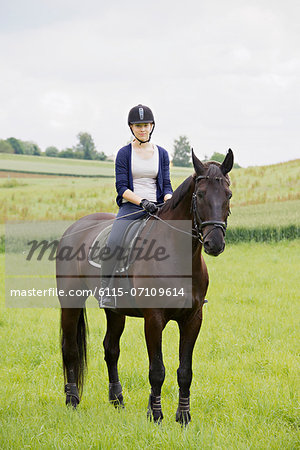 Woman Riding Horse in Rural Landscape, Baden Wuerttemberg, Germany, Europe Stock Photo - Premium Royalty-Free, Image code: 6115-07109614