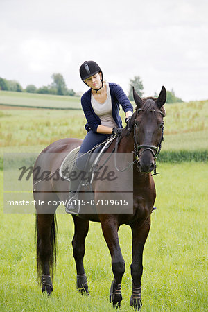 Woman Riding Horse in Rural Landscape, Baden Wuerttemberg, Germany, Europe Stock Photo - Premium Royalty-Free, Image code: 6115-07109615