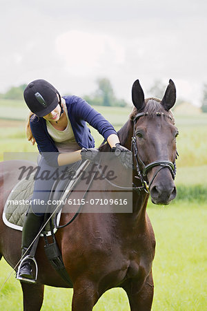 Woman Riding Horse in Rural Landscape, Baden Wuerttemberg, Germany, Europe Stock Photo - Premium Royalty-Free, Image code: 6115-07109616