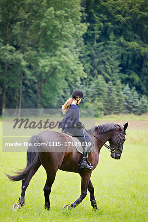 Woman Riding Horse in Rural Landscape, Baden Wuerttemberg, Germany, Europe Stock Photo - Premium Royalty-Free, Image code: 6115-07109619