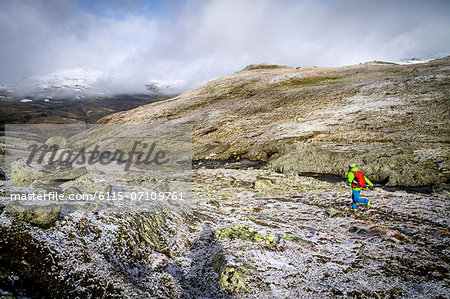 Man speed hiking along rocky grounds, Norway, Europe