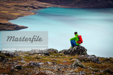 Hiker taking a rest a fjord, Norway, Europe
